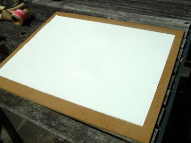 The paper, soaked and ready to tape to the board