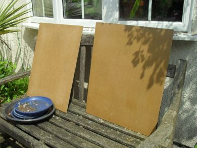The boards with freshly-stretched paper, standing up to dry. The paper is facing inwards to keep it clean and avoid interference from cats.