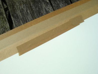 A certain amount of remedial or rescue-work can be done to the stretched paper, providing only a small part has already come unstuck