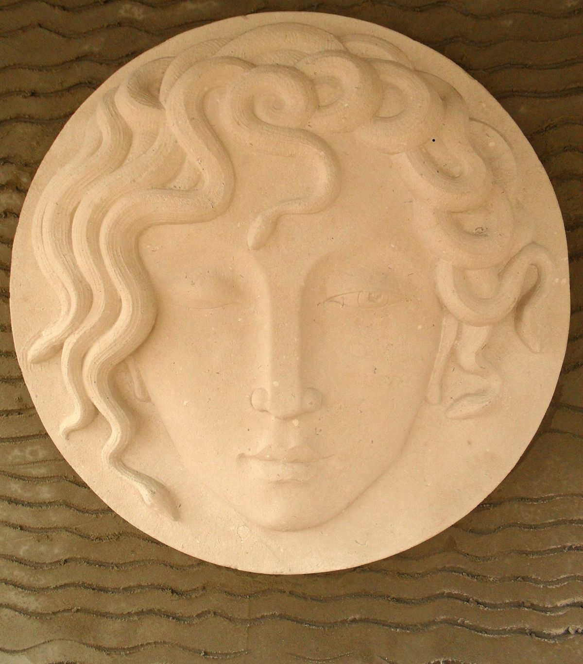 Medusa - carving by Tom Clark from a sketch by Nancy Farmer