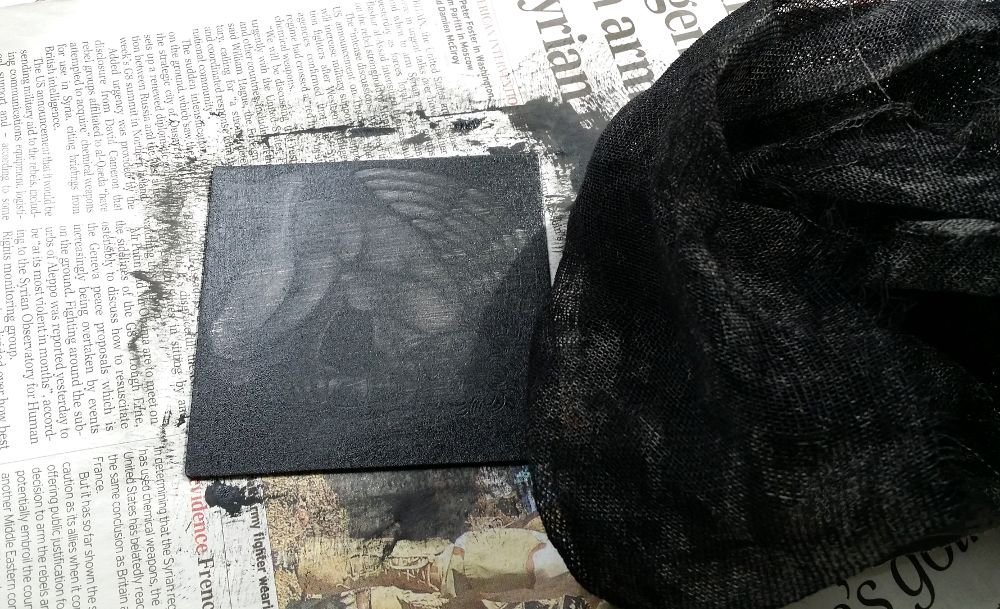 the mezzotint plate, still covered in excess ink