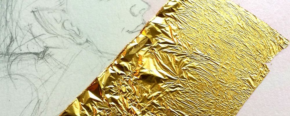 first piece of gold leaf on the gold size